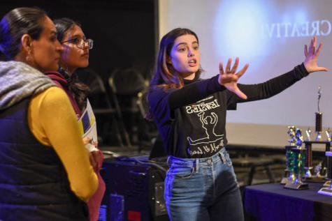 Alaina Arbiso (10) presents the features of the blackbox during a tour of the theater department. Future stallions were taken around the F building with their parents at Stalli上 Showcase to promote VAPA.